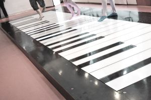 People dancing on a piano stage