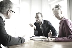 Nonprofit coworkers in discussion in conference room