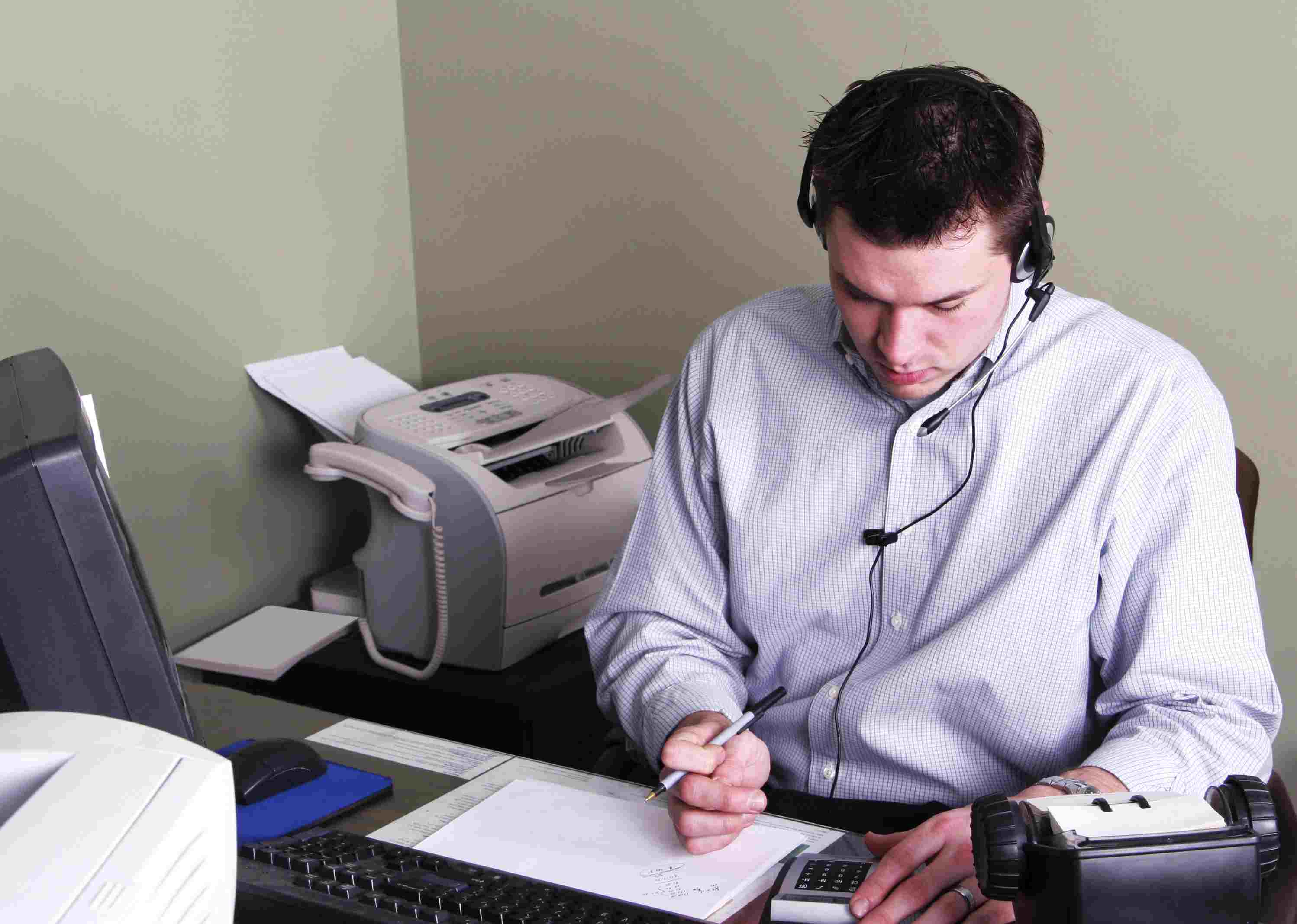 Young man working on income taxes at his desk
