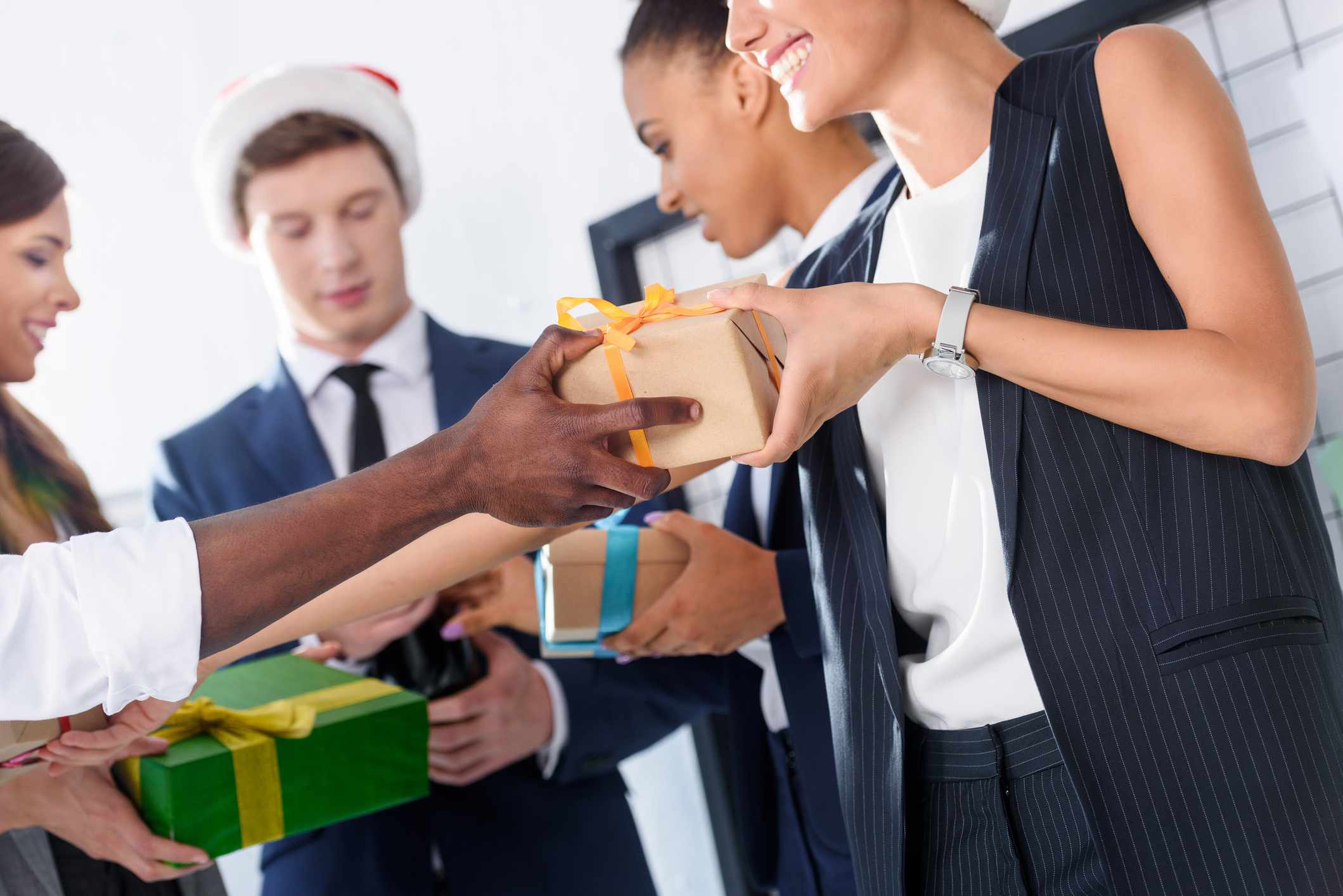 Business people exchanging gifts in office