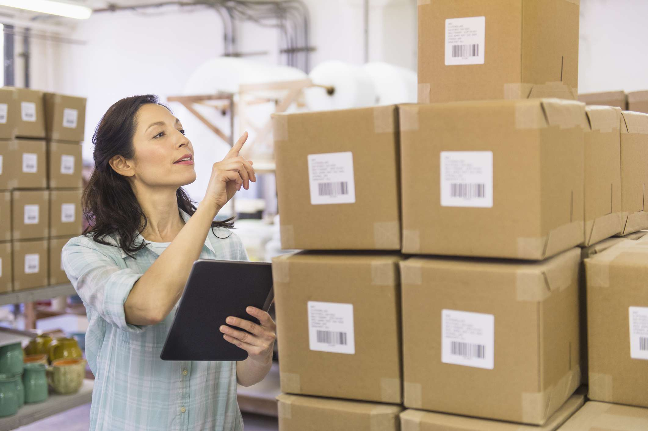 Woman counting boxes of inventory