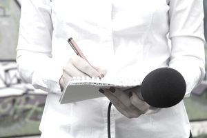 a reporter writing in a notebook