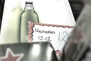 A point-of-purchase ad for Heineken Premium Light beer lies on display in a grocery store
