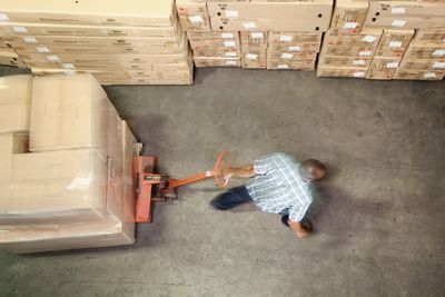 Man working in delivery warehouse using SAP Software
