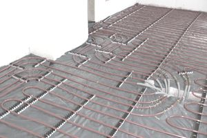 Pipes laid in the floor while installing a radiant floor heating system.