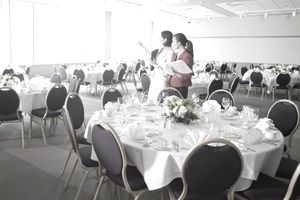 Event manager working in a banquet hall before a luncheon