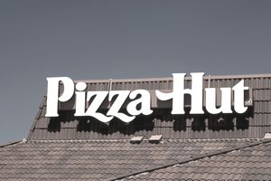 Sign on a Pizza Hut founded by Frank and Dan Carney