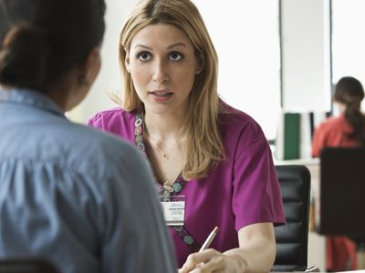 Nurse talking to a patient in a medical office