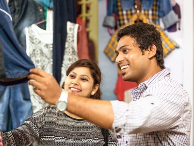 Happy Indian couple shopping together