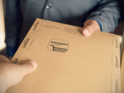 Person Handing Another Person an Amazon Package