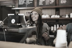 A barista working at a small coffee shop, started using an SBA 7(a) loan.