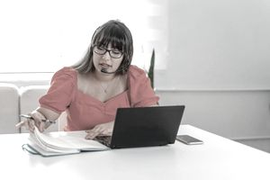 Woman on her laptop with headset
