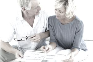older couple calculating finances
