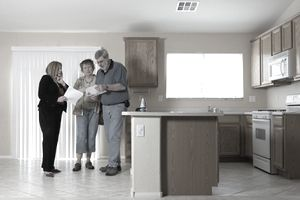 A Las Vegas real estate agent shows homes to a couple.