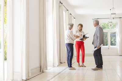 Couple talking to real estate agent about an appraisal