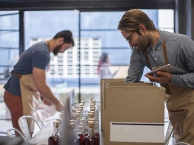 Two men shipping bottled products