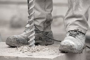 Muddy construction boots