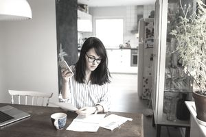 Woman creating a budget in her home