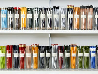 Variety of pencils in cups on store shelves