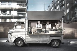Two women working in a food truck
