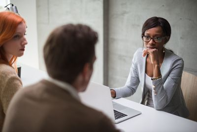 Young couple meeting with professional in an office