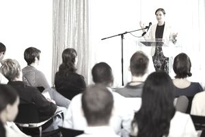 Woman speaking to a group of people