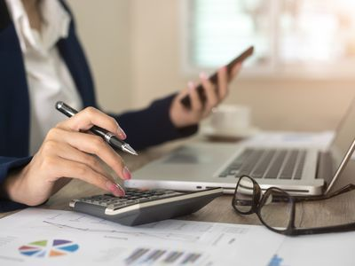 Woman calculating an annuity's present and future values