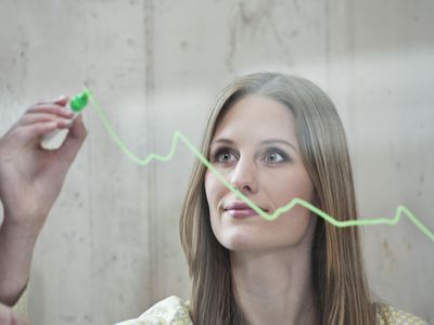 woman drawing on glass with erasable marker