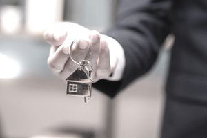 Home concept,Businessmen holding home keys