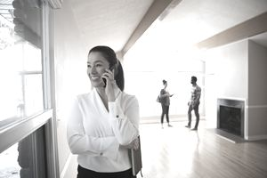 Realtor on phone showing new home
