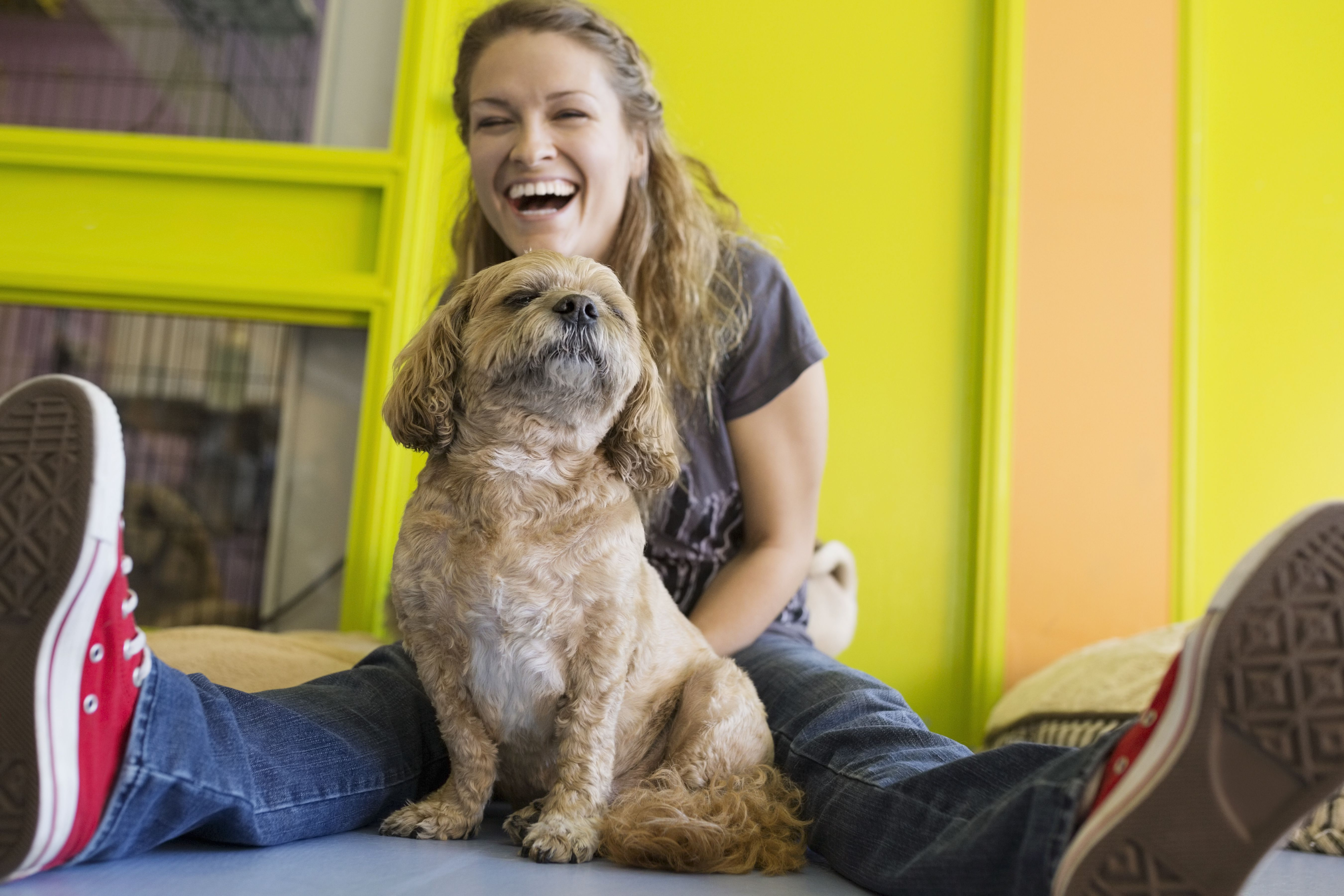 Laughing woman with dog