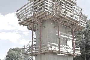 Climbing formwork around a concrete tower under construction
