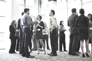 Business people attending a networking event