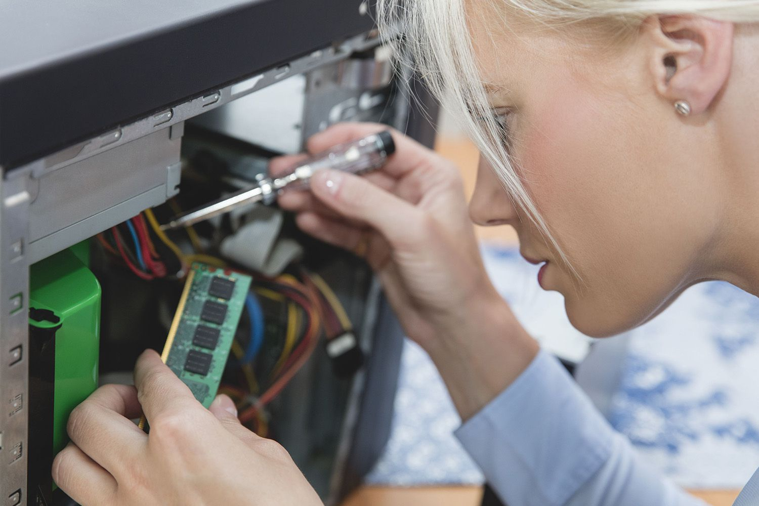 Technology consultant assembling RAM in computer as a freelance on-demand provider..