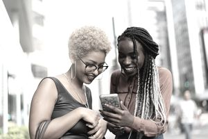 2 women looking at a cell phone