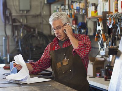 Business owner sorting through paperwork and financials