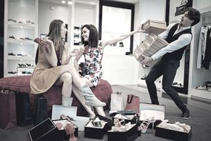 Advertisement showing women shopping for shoes as a stereotype