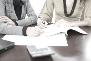 accountant and business owner with paperwork