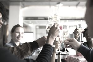 Business people toasting champagne flutes while celebrating Christmas