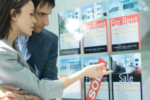couple looking at real estate for rent ads