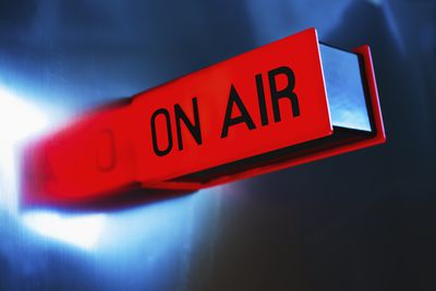 Studio shot of on air glowing sign