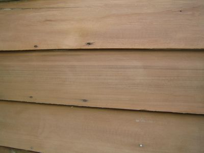 a close-up unpainted wood needing preparation before painting to create a better finished results.