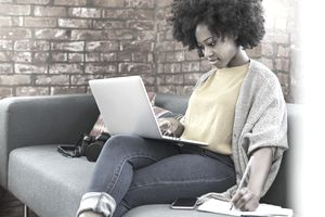 Woman at laptop finding ideas for business