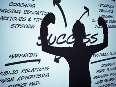 Woman's silhouette on screen with business topics