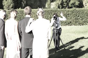 Wedding photographer taking a family photo