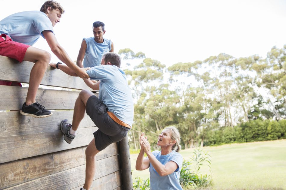 team members on an obstacle course
