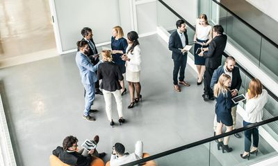 A group of business people at a small event