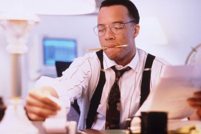 Man Calculating the S-Corporation Income Taxes