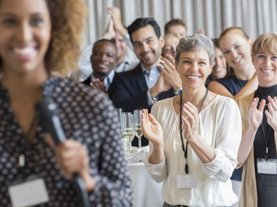 Group of people applauding after speech during conference