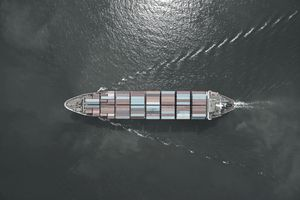 Aerial view of cargo ship, cargo container in warehouse harbor at thailand .